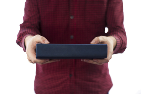 big bible: Man holding closed book isolated on white Stock Photo