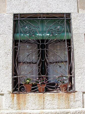 Window with iron ornament Stock Photo - 7397244