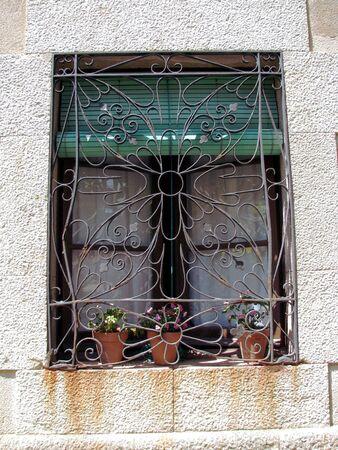 Window with iron ornament Stock Photo - 7397244