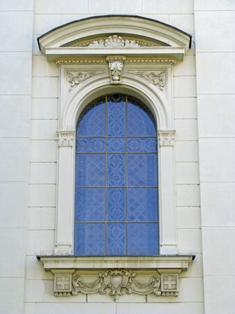 Blue window and ornamented facade photo