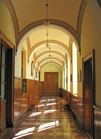 the sun shines through the window into the corridor