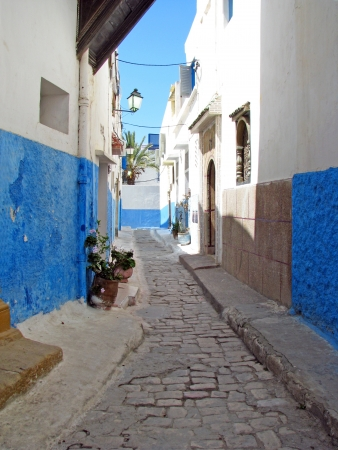 Narrow blue and white street of Rabat Morocco photo