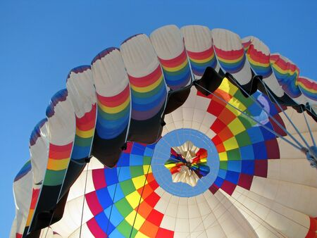 Colorful hot air balloon getting ready for landing