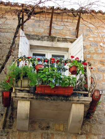 Mediterranean balcony with flowers and Christmas decoration