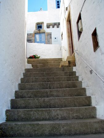 Stairs in the narrow white Mediterranean alley