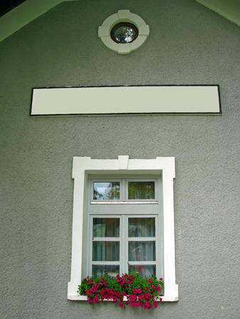 white window with flower pots and tag to write a name