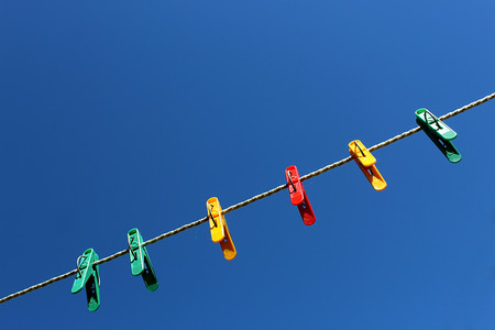 clothespin for fixing the laundry to the cloudless sky