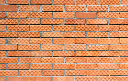 texture brick wall of orange color grooved