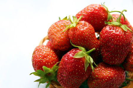 small basket of delicious juicy ripe strawberries