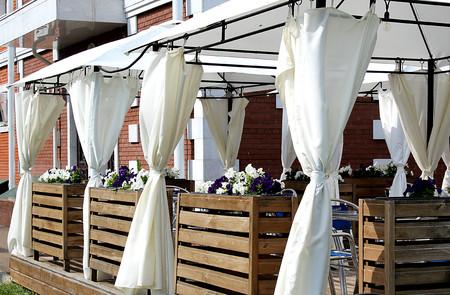 a verandah at a cafe under a canopy Stock Photo