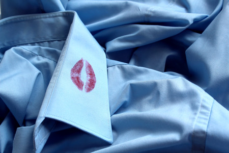 traces of lipstick on the collar of a man's shirt