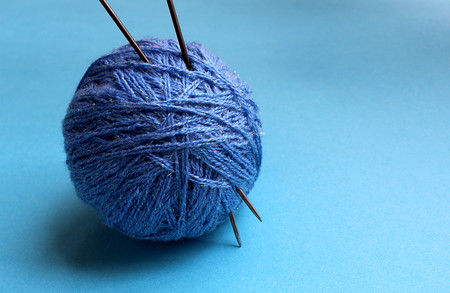 A ball of blue knitting yarn for knitting Archivio Fotografico
