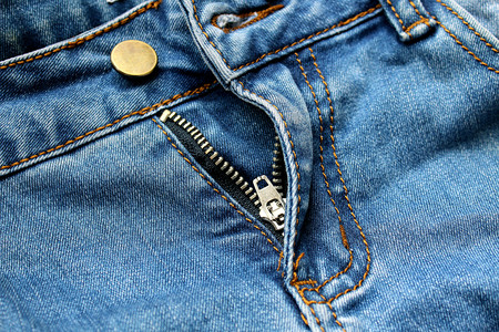texture zipper golden open on blue jeans