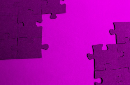 Puzzles laid out on the table Stock Photo