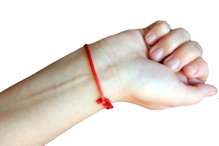 red thread tied at the wrist