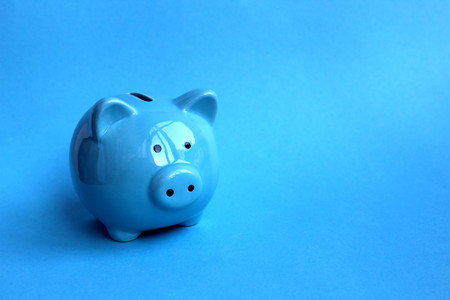 Blue piggy moneybox on blue background a symbol of 2019 Stok Fotoğraf