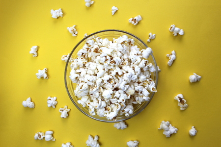 Salted crispy popcorn lies on a glass plate