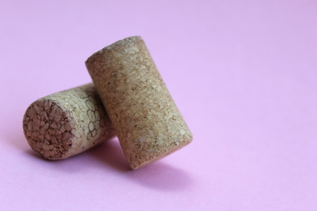 wine cork two pieces on a pink background