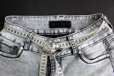Gray jeans wrapped on a belt