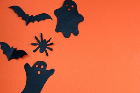 Halloween holiday concept with paper black bats, spider and ghosts