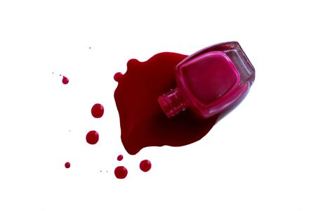 Spilled and open nail polish with a
