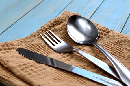 Cutlery spoon, fork, knife lie on the table Фото со стока
