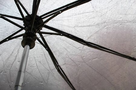 black umbrella with water drops, inside view Stock fotó