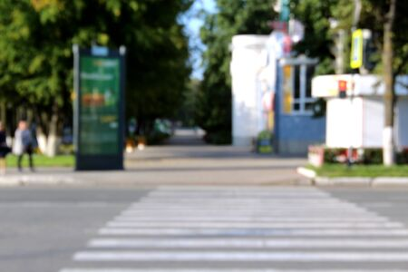 blurred photo of a pedestrian crossing on a morning sunny day
