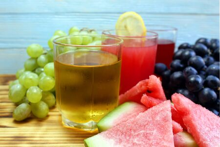 three types of juice in glasses, watermelon, grapes, green and black Stock Photo