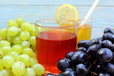 two glasses of fresh juice from different grape varieties