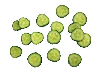 texture of sliced cucumber circles on a white background Stock Photo