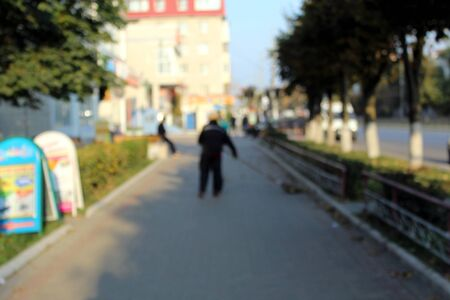 blurred background street sweeper sweeping city sidewalk Foto de archivo