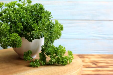 there is a lush bouquet of fresh parsley on the table Stock Photo