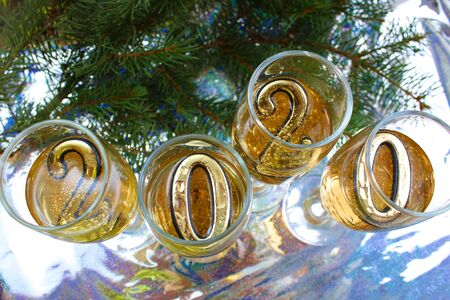glasses with champagne and numbers 2020