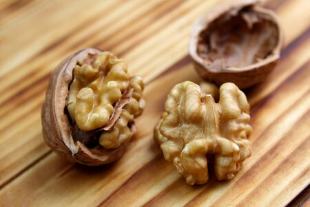 chopped walnuts lie on a wooden table 写真素材