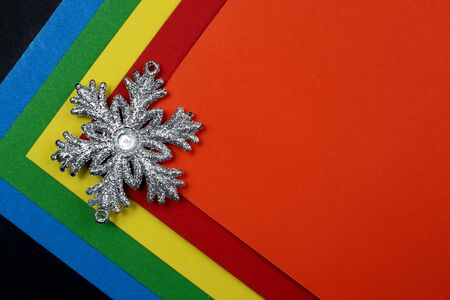 abstract texture on a colorful background lies a snowflake Stockfoto
