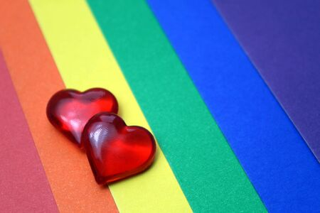 Rainbow homosexual color background with red hearts