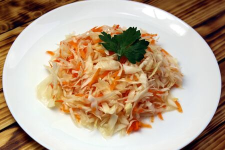 Shredded coleslaw with carrots sauerkraut in a plate