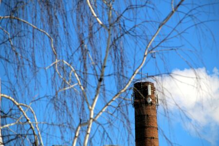 In winter, smoke comes out of the chimney when heating buildings