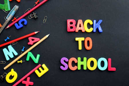 The words back to school are written on a black background