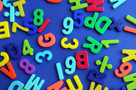 Multicolored letters and numbers on a blue background