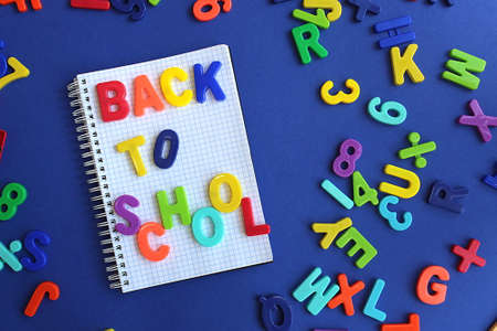 The words back to school are written on a blue background