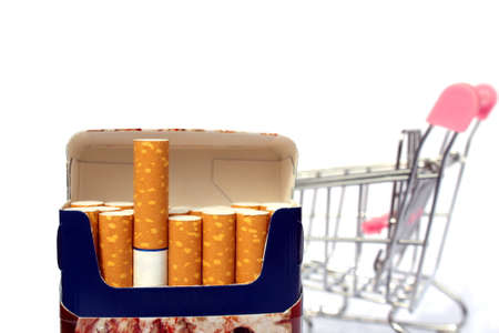 A pack of cigarettes on the background of a shopping cart