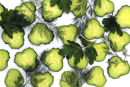Texture of sliced cucumbers with parsley and dill Stock Photo