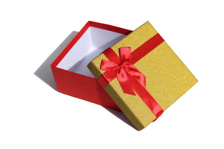 Open gift box lies on a white background