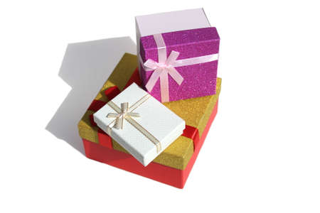 Three gift boxes of different colors stand on a white background Stock Photo - 155928453