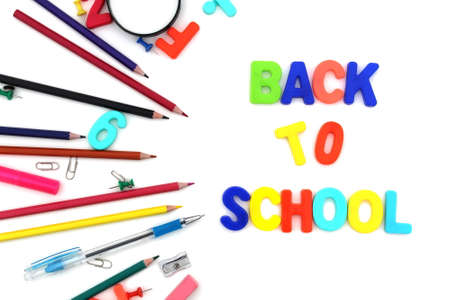 Lettering back to school with stationery on white background