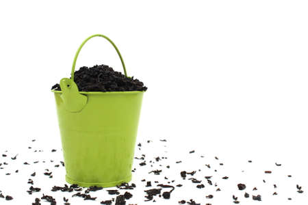 Decorative bucket with dry leaves of black loose tea Stock Photo