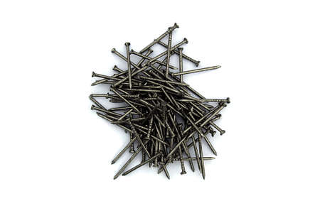 A pile of iron nails lie on a white background Archivio Fotografico