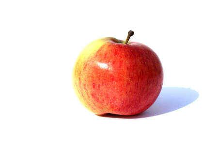 Red ripe delicious apple stands on a white background Stock Photo
